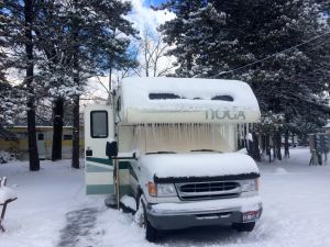 Snow and Ice Covered Motor Home